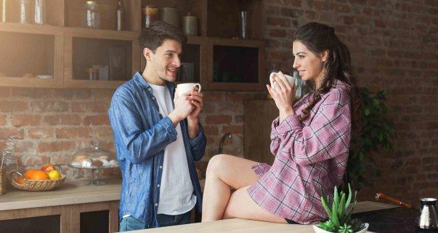 Couple drinking coffee in their loft kitchen