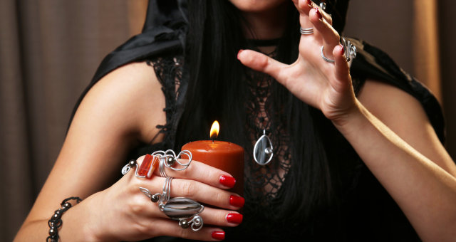 Witch — fortune teller on dark background