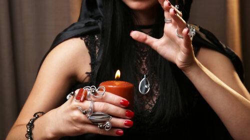 Witch — fortune teller on dark background