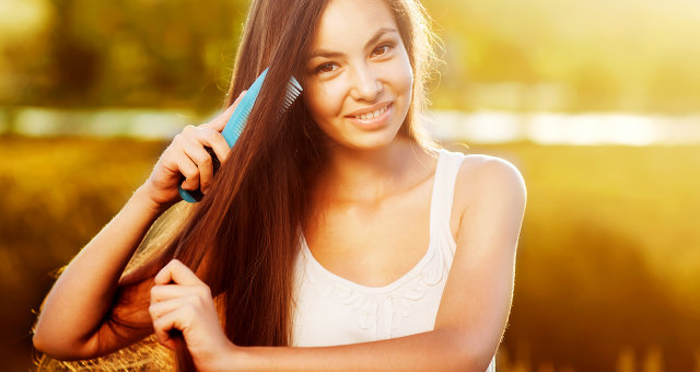 beautiful girl combs her hair Asian appearance