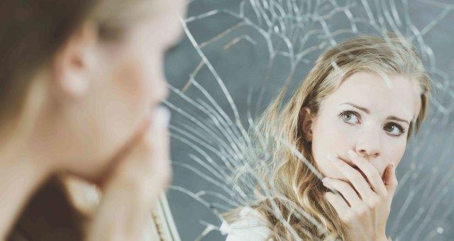 Girl and broken mirror