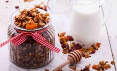 Granola from several types of cereals with nuts,honey,raisins