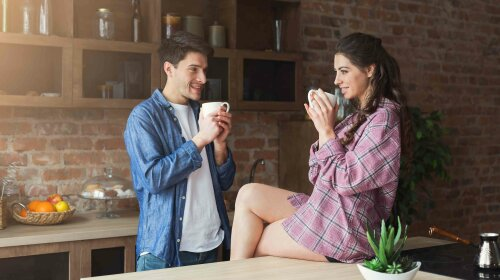 Couple drinking coffee in their loft kitchen
