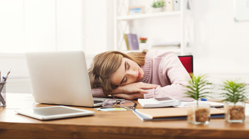 Sleeping overworking business woman at office