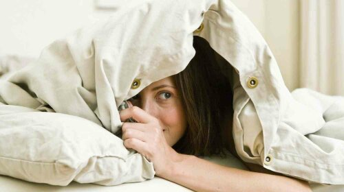sex-love-life-2012-12-young-woman-hiding-bed-main