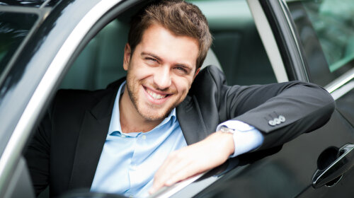 bigstock-Handsome-man-in-his-new-car-38742049