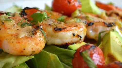 Salad with shrimps avocado tomato