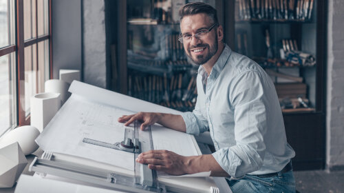 Smiling architect at work