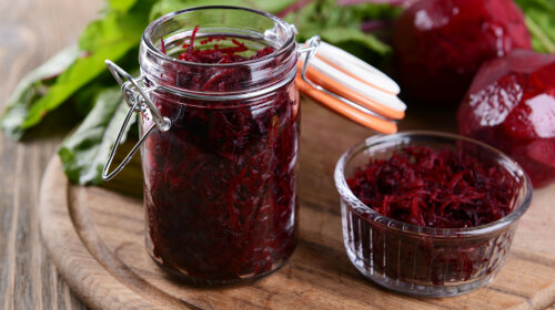 30039106 — grated beetroots in jar on table close-up