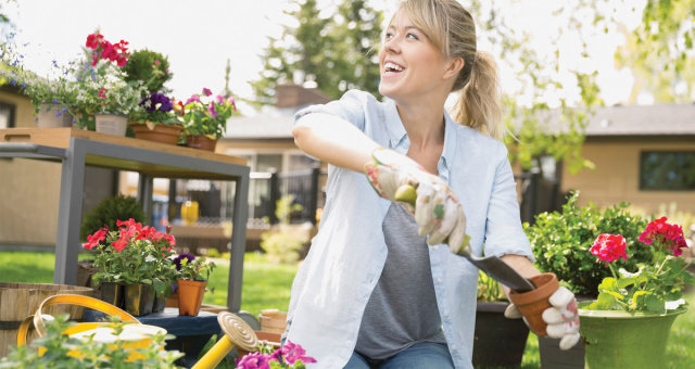 complements_smiling-woman-planting-flowers-in-garden_masterfile-69-web