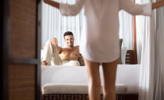 woman seduces her boyfriend in the bedroom