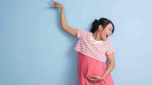 dancing pregnant woman
