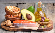 fish_food_olive_nuts_avocado_wood_planks_cutting_521542_1280x849