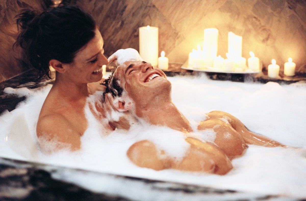 Naked couples making love in a hot tub 1